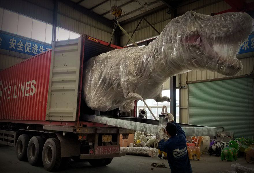 Loading dinosaurs into containers